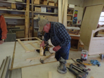 Bill Palmer in his work shop working on the big table